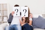 couple on couch with questions